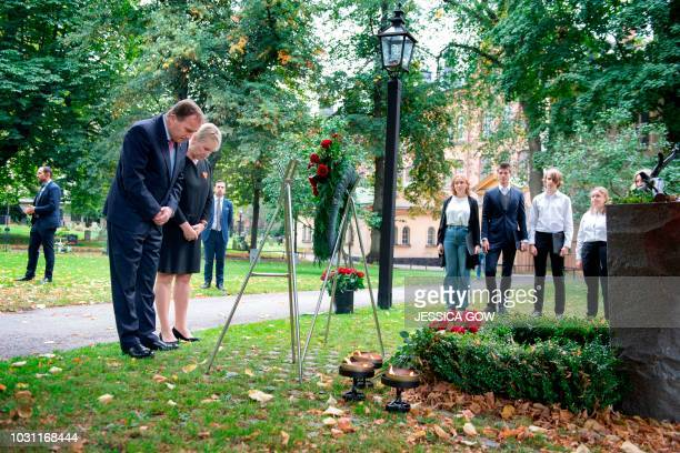Swedish Prime Minister Stefan Löfven and Foreign Minister Margot Wallström visit the grave of late Swedish Foreign Minister Anna Lindh to mark 15...