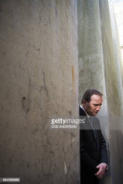 Swedish Prime Minister Stefan Loefven is seen among the concrete pillars at the 'Garden of Exile' during a visit to the Jewish museum in Berlin on...