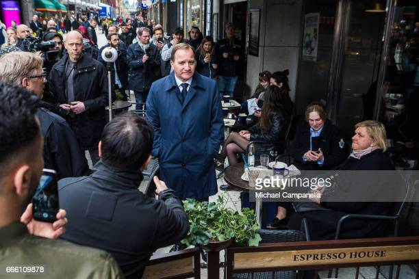 Swedish Prime Minister Stefan Lofven greets citizens at a cafe near the scene of the terrorist truck attack in downtown Stockholm on April 8 2017 in...