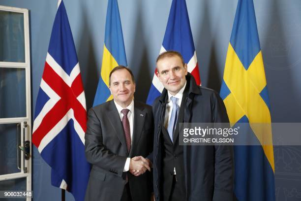 Swedish Prime Minister Stefan Lofven shakes hands with Iceland's President Gudni Thorlacius Johannesson as they meet at the government headquarters...