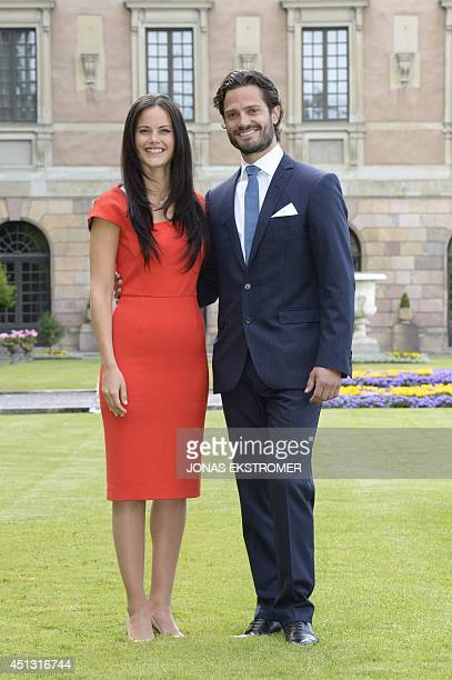Swedish Prince Carl Philip poses with former model Sofia Hellqvist in the garden of the Stockholm Palace on June 27 2014 during a press statement to...