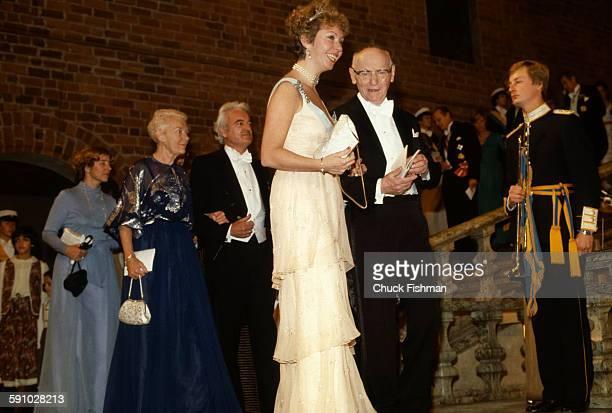Swedish Princess Christina Mrs Magnuson escorts Polishborn American author Isaac Bashevis Singer at the Nobel Prize presentation ceremony Stockholm...