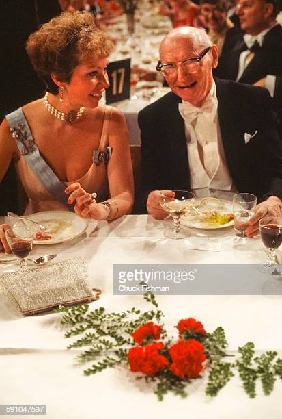Swedish Princess Christina Mrs Magnuson shares a laugh with Polishborn American author Isaac Bashevis Singer at the Nobel Prize ceremony banquet...