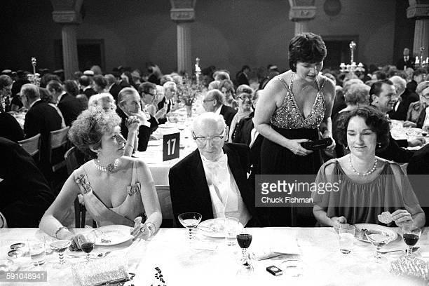 Swedish Princess Christina Mrs Magnuson sits with Polishborn American author Isaac Bashevis Singer at the Nobel Prize ceremony banquet Stockholm...