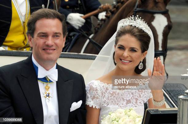 Swedish Princess Madeleine and her husband Chris O'Neill drive in a carriage from the Royal Palace to Riddarholmen after their wedding in Stockholm,...