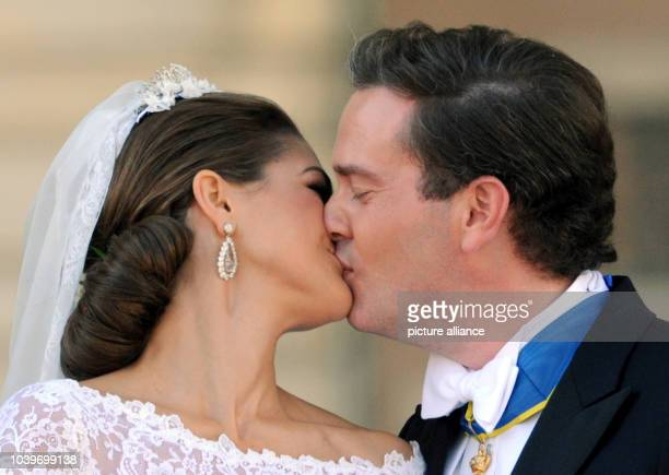 Swedish Princess Madeleine and her husband Chris O'Neill kiss at the Royal Palace after their wedding in Stockholm, Sweden, 08 June 2013. Photo:...