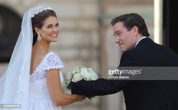 Swedish Princess Madeleine and her husband Chris O'Neill leave after their wedding at the Royal Palace in Stockholm, Sweden, 08 June 2013. Photo:...