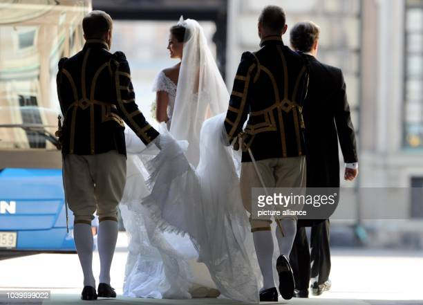Swedish Princess Madeleine and her husband Chris O'Neill leave the Chapel of the Royal Palace in Stockholm Sweden after their wedding on 08 June 2013...