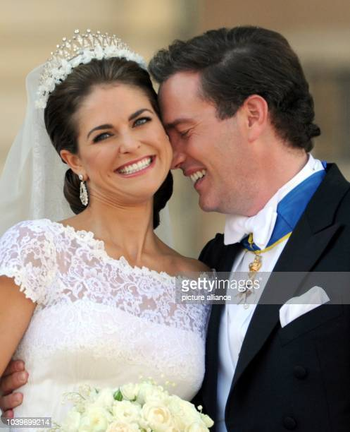 Swedish Princess Madeleine and her husband Chris O'Neill leave the Chapel of the Royal Palace in Stockholm, Sweden, after their wedding 08 June 2013....