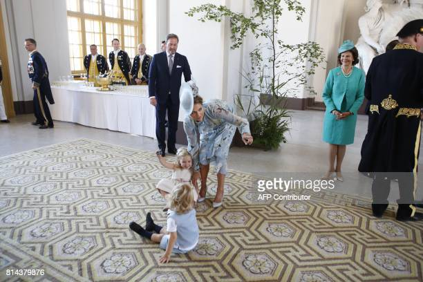 Swedish Princess Madeleine and her husband Christopher O'Neill Queen Silvia look at Princess Leonore playing with Prince Nicolas at the Royal Palace...