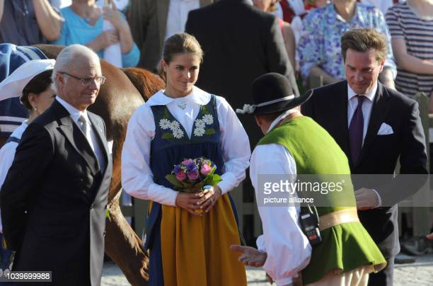 Swedish Princess Madeleine and her husbandtobe Chris O'Neill King Carl XVI Gustaf and Queen Silvia arrive at the Swedish national day reception in...