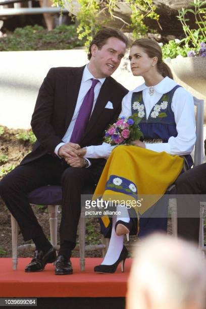 Swedish Princess Madeleine and her husbandtobe Chris O'Neill sit next to each other at the Swedish national day reception in Stockholm Sweden 06 June...