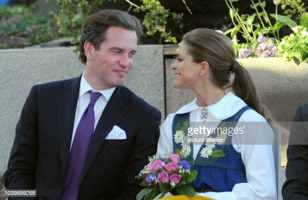Swedish Princess Madeleine and her husbandtobe Chris O'Neill smile at each other at the Swedish national day reception in Stockholm Sweden 06 June...