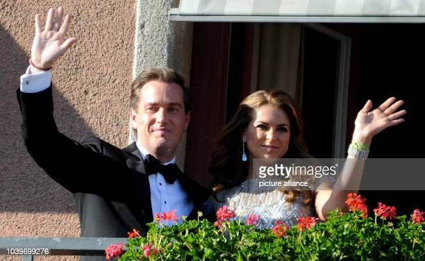 Swedish Princess Madeleine and her husbandtobe Chris O'Neill wave from the balcony of the Grand Hotel in Stockholm Sweden 07 June 2013 prior to a...