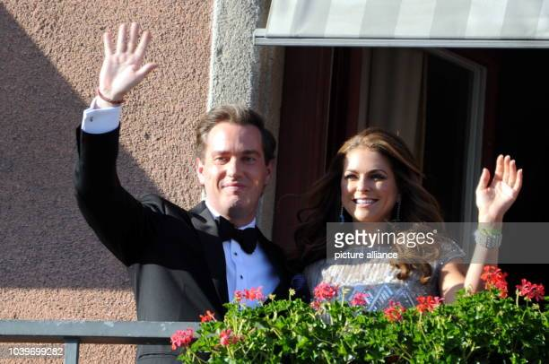 Swedish Princess Madeleine and her husband-to-be Chris O'Neill wave from the balcony of the Grand Hotel in Stockholm, Sweden, 07 June 2013, prior to...