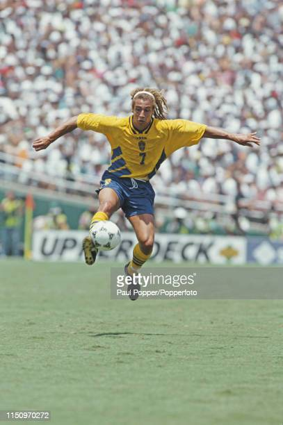 Swedish professional footballer Henrik Larsson pictured with the ball during play between Sweden and Bulgaria in their 1994 FIFA World Cup third...