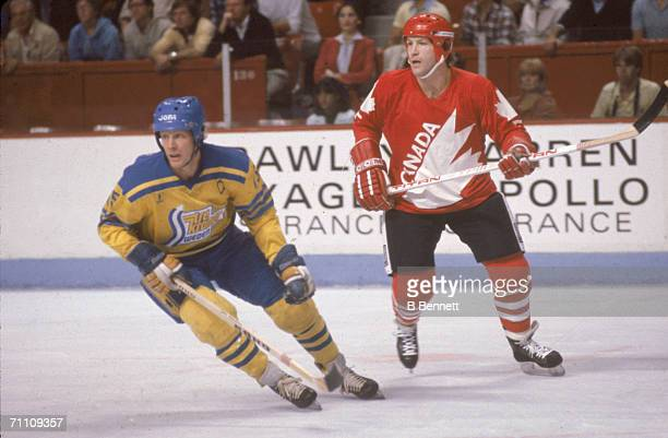 Swedish professional hockey player Anders Hedberg and Canadian professional hockey player Denis Potvin in action during a game at the 1981 Canada Cup...