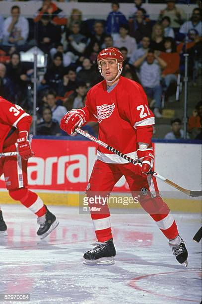 Swedish professional hockey player Borje Salming of the Detroit Red Wings skates and watches the action during a game against the New York Islanders...