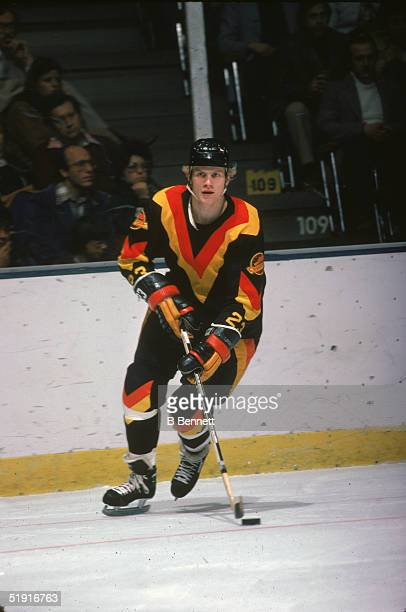 Swedish professional hockey player Thomas Gradin forward of the Vancouver Canucks skates on the ice during an away game against the New York...