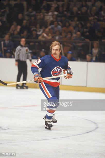 Swedish professional ice hockey player Bob Nystrom of the New York Islanders skates on the ice without a helmet during a road game against the New...