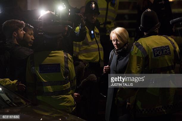 Swedish prosecutor Ingrid Isgren passes British police officers as she leaves the Ecuadorian Embassy in London on November 14, 2016 where WikiLeaks...