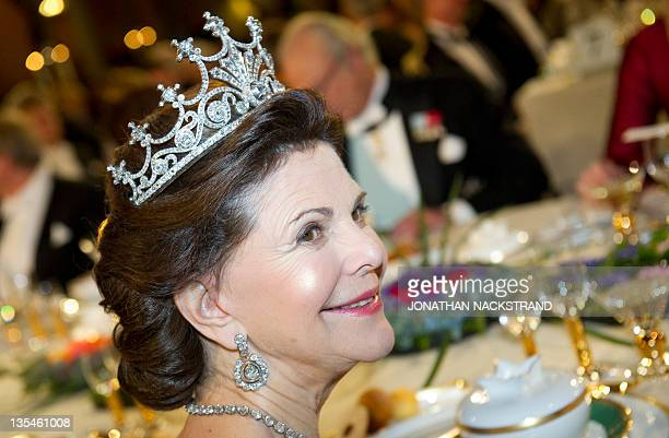 Swedish Queen Silvia sits at the honorary table of Nobel banquet following the 2011 Nobel Prize award Ceremony at Stockholm Town Hall on December 10...