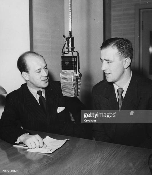 Swedish radio commentator Helge Hurland interviewing boxer Olle Tandberg in front of a radio microphone circa 1938