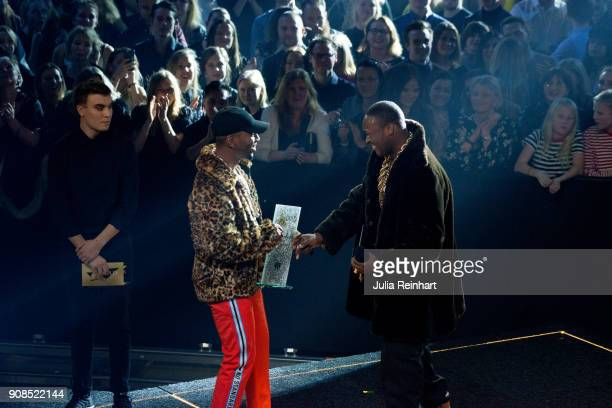 Swedish rapper Lamix winner of the Artist of the Future award hand the prize for Artist of the Year to his friend Jireel at the P3 Guld Gala Swedish...