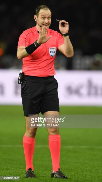 Swedish referee Jonas Eriksson reacts during the international friendly football match between Germany and Brazil in Berlin on March 27 2018 / AFP...