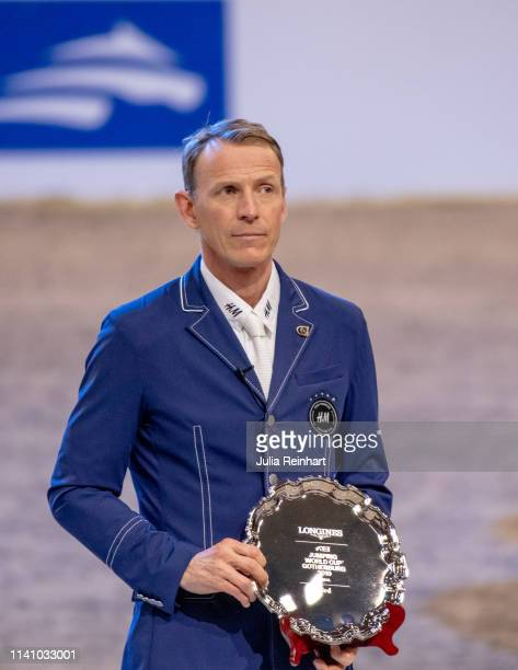 Swedish rider Peder Fredricson shows off his third place trophy during the price giving ceremony for the 2019 Longines FEI Jumping World Cup Final...