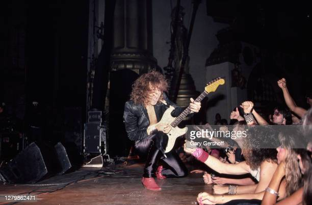Swedish Rock and Heavy Metal musician Yngwie Malmsteen plays guitar as he performs onstage at the Beacon Theatre, New York, New York, July 18, 1985.