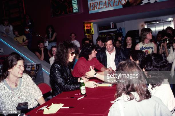 Swedish Rock and Heavy Metal musician Yngwie Malmsteen signs an autograph for a fan at the Greenwich Village branch of Tower Records, New York, New...