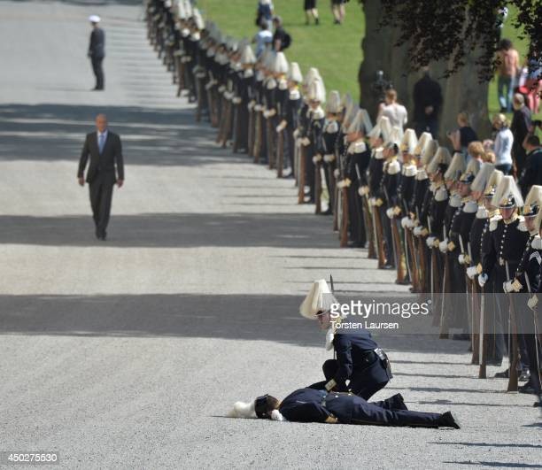 Swedish Royal Guard collapses during Princess Leonore's Royal Christening at Drottningholm Palace Chapel on June 8 2014 in Stockholm Sweden
