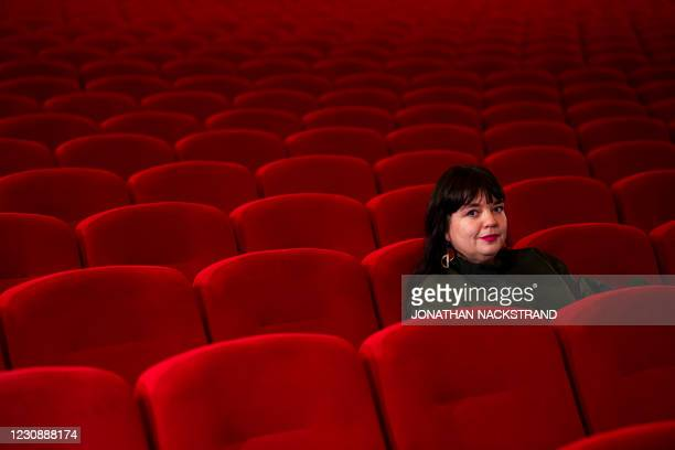 Swedish Sandra Fogel watches a movie alone among empty seats in a cinema hall during the Gothenburg Film Festival, on January 30, 2021 in Gothenburg,...