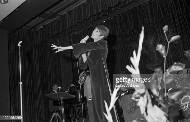 Swedish schlager singer Siw Malmkvist in the TV show 'Der goldene Schuss', Germany late 1960s.