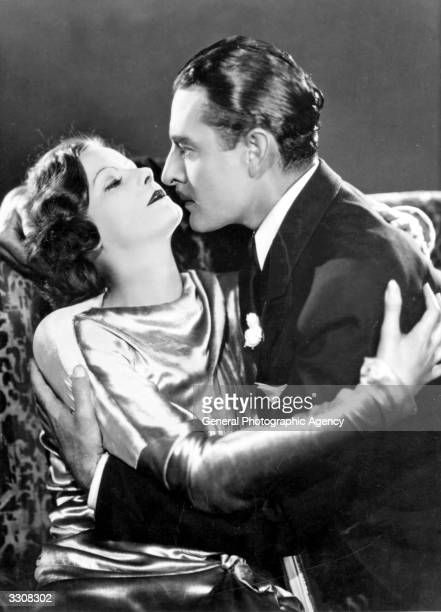 Swedish screen Goddess Greta Garbo shares an intimate embrace with American leading man John Gilbert in a scene from the film 'A Woman Of Affairs'...