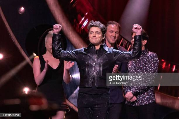 Swedish singer and former soccer player Anders Johnson celebrates after advancing to the semifinals in the second heat of Melodifestivalen Sweden's...