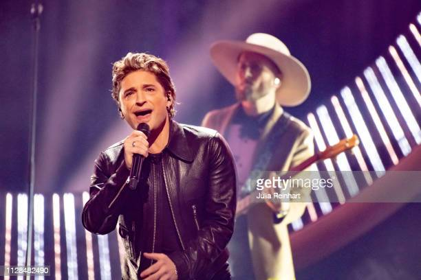 Swedish singer and former soccer player Anders Johnson participates in the second heat of Melodifestivalen Sweden's competition to select the...