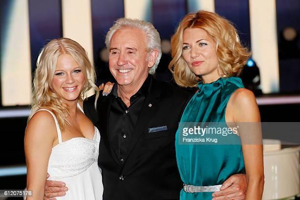 Swedish singer Julia Lindholm british musician Tony Christie and german singer Ella Endlich during the tv show 'Willkommen bei Carmen Nebel' at...