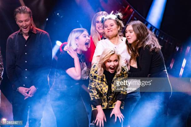 Swedish singer Malou Prytz and her team celebrate after advancing to the finals in the second heat of Melodifestivalen Sweden's competition to select...