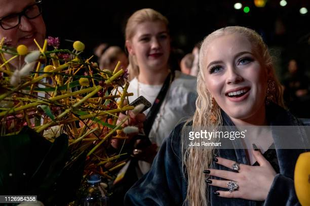 Swedish singer Wiktoria Johansson speaks to the press after advancing to the final in the first heat of Melodifestivalen Sweden's competition to...