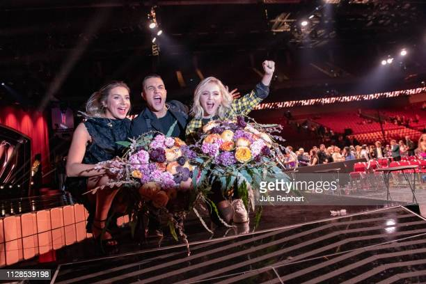 Swedish singers Malou Prytz Hanna Fern and Liamoo celebrate after advancing to the finals in the second heat of Melodifestivalen Sweden's competition...