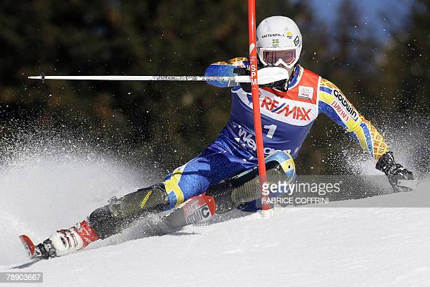 Swedish ski racer Markus Larsson clears a gate during the slalom event to place sixth in the Men's FIS Alpine World Cup super combined 11 January...
