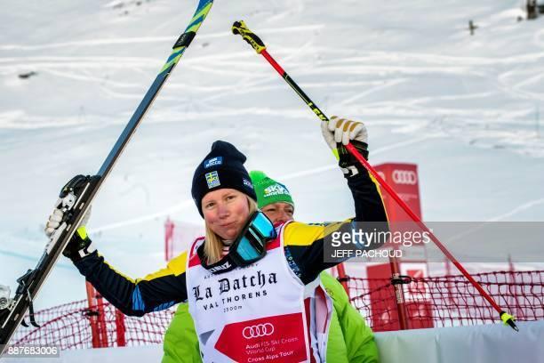 Swedish skier Sandra Naeslund celebrates after winning the FIS Women Ski Cross World Cup on December 7 2017 at the ValThorens ski resort in the...