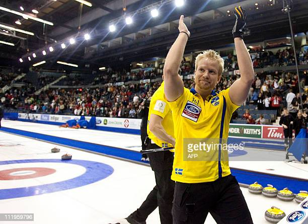 Swedish skip Niklas Edin acknowledges the crowd following his 76 win over Norway in the bronze medal match at the Ford World Men's Curling...