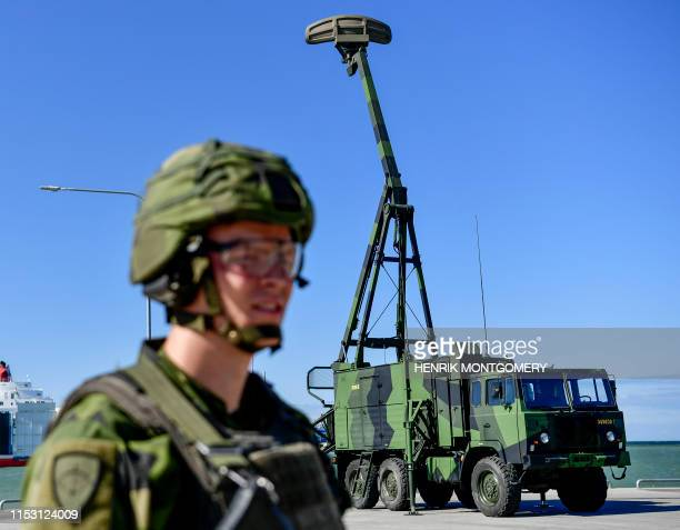 A Swedish soldier stands in front of a search radar system in Visby Sweden on July 1 2019 Sweden's armed forces said it had deployed a new...