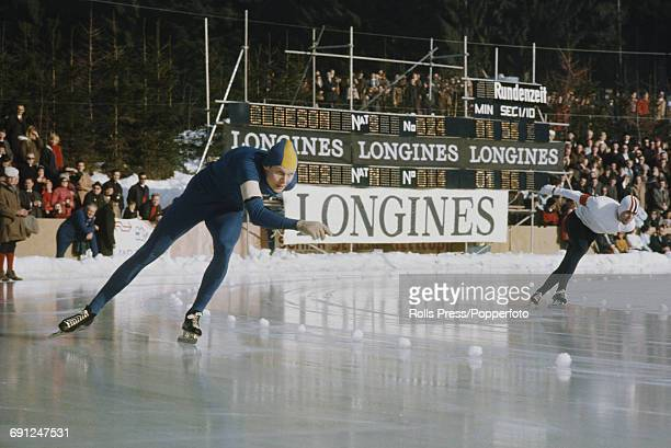 Swedish speed skater Goran Claeson pictured left in competition in the 1969 European Speed Skating Championships event on an ice covered long track...