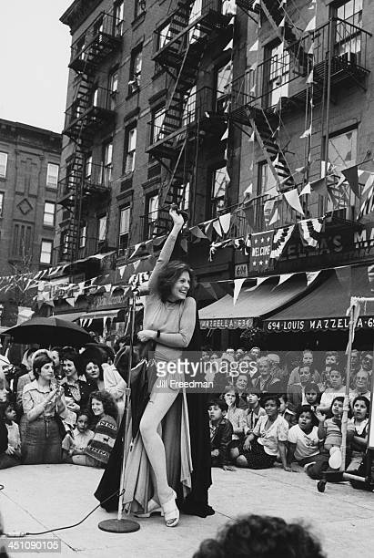 Swedish stage and film actress Viveca Lindfors performs excerpts from her show 'I Am A Woman' on stage at a street fair in New York City 1974