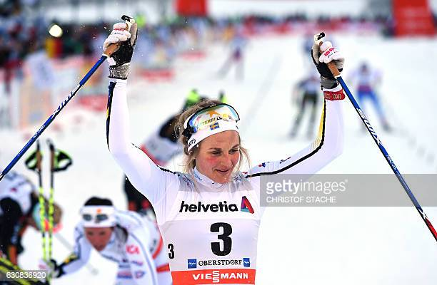 """Swedish Stina Nilsson reacts after she passed the finish line of the ladies 5 kilometer skiathlon competition of the """"Tour de Ski"""" Cross Country..."""