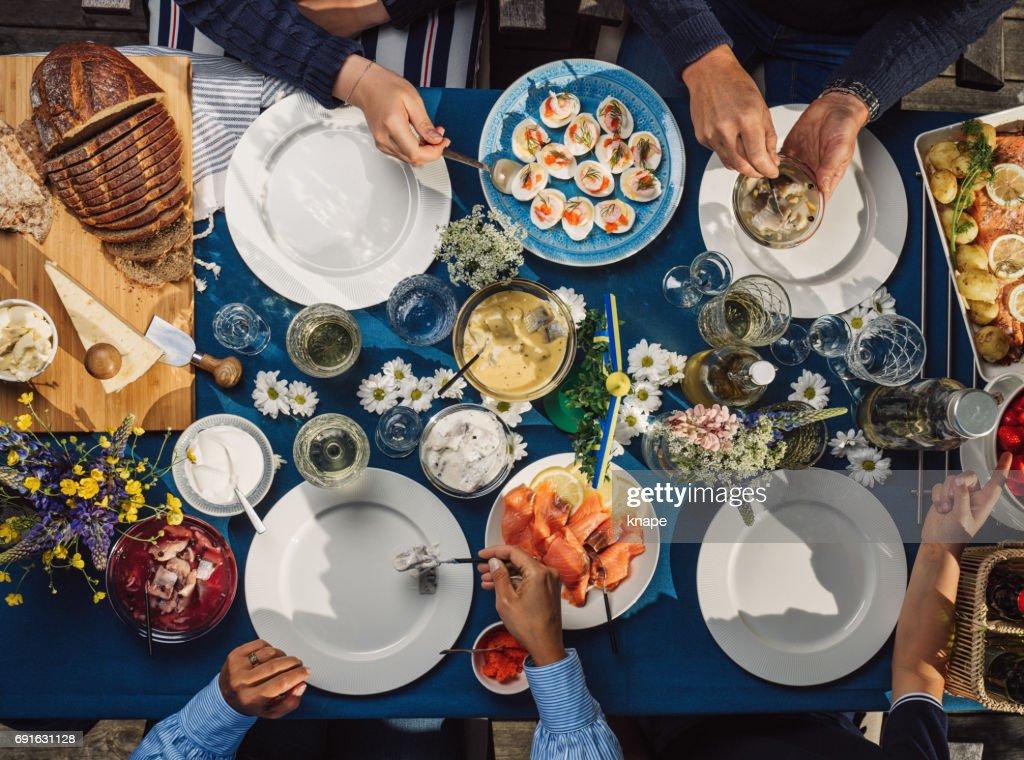 Swedish summer Midsommar Midsummer celebration dinner party : Stock Photo